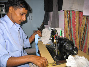Raju working with his new Prem sewing machine