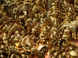 Brass figurines at an outdoor bazaar in Saraj Kund