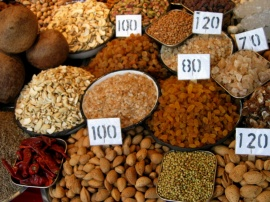 Almonds, raisins, coconuts, and more for sale at a spice bazaar in New Delhi
