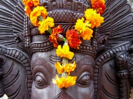A marigold wreath decorating the head of Ganesha, the elephantine god of auspicious beginnings