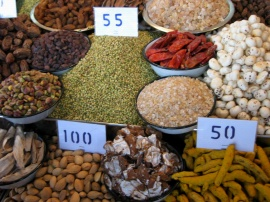 Lentils, almonds, cococut, and turmeric for sale at the New Delhi spice market